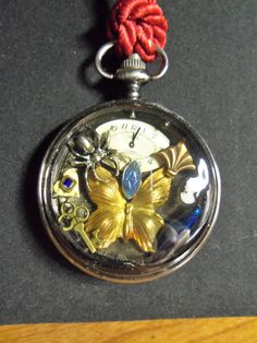 Steampunk Pocket Watch Case Necklace. $20.99, via Etsy.