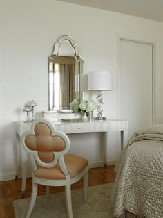 A small dressing table is a classic bedroom fixture, creating a relaxing spot for applying makeup or even doing bills.