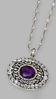 An antique amethyst and diamond pendant-brooch, c1900