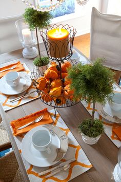 i love this entire table especially love the placemats and whatever that centerpiece is that holds the candle and mini pumpkins