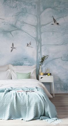 Snooze easily under this heavenly wallpaper design. Defining white paint textures help to create a story for your walls, while swooping birds create another dimension to this unique landscape. Designed by the talented Louise Body, this wallpaper is a truly unique way to dress your walls.