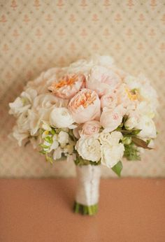 Beautiful Wedding Bouquet With: White Ranunculus, White Freesia, White Carnations, Pastel Peach English Garden Roses, Pastel Pink English Garden Roses, Pastel Pink Spray Roses