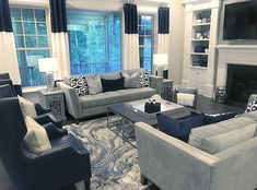 Sharon R Frank, Realtor on Now let me tell you.I love blue decor and these blue glass windows paired with navy blue furniture and accents in this room is absolutely Living Room Decor Grey And Blue, Blue Family Rooms, Silver Living Room, Blue Living Room Decor, Home Living Room, Living Room Designs, Gray Decor, Blue Living Room Furniture, Navy Blue Furniture