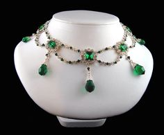 The emerald and diamond necklace which has matching earrings formed part of the marriage parure of Stephanie de Beauharnais, a relative of the Empress Josephine, who was married in 1806 to the heir of the Grand Duke of Baden. The stones were mounted in open back settings which were very delicate. The diamonds were set in silver and lined with gold.