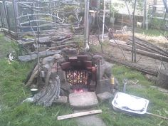 My inground, BBQ pit. I recycled old bricks made in the area circa 1880 insde the stones and old BBQ racks layered for cooking/heating.