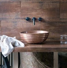 Perfect for adding an industrial look in the bathroom, these extra-large metallic wall tiles make an eye-catching backdrop for the handcrafted basin. Diy Bathroom, Copper Bathroom, Bathroom Basin, Rustic Bathrooms, Modern Bathroom Decor, Bathroom Trends, Bathroom Interior, Small Bathroom, Bathroom Ideas