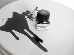 porcellain paint  two rules: the plates must be very clean, no fat or grease, and don't make your splodges too thick, otherwise the paint will blister. Drop some paint onto the plate from about 1 meter above. Tilt the plate a bit so that the paint can flow. Let dry and put it into the oven
