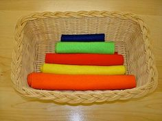 Montessori rolling mats of different widths.  Would be interesting to the colors of the rainbow and the children could sort it out.