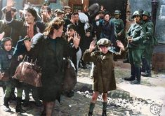 found this picture. Bewildered and frightened Jewish Poles are forcibly removed from their hideout during the deportation of all of the Jews in the Warsaw Ghetto, May, 1943.