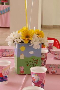 Floral centerpiece at a Peppa Pig birthday party! See more party ideas at CatchMyParty.com!
