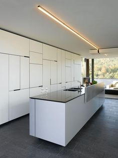 The modern House B-Wald by Alexander Brenner is located in Stuttgart, Germany. Welcoming owners and guests with a dark gate flanked by two anthracite walls, the modern residence displays its… Modern Kitchen Design, Interior Design Kitchen, Modern Interior, Kitchen Decor, Kitchen Designs, Nice Kitchen, Decorating Kitchen, Interior Architecture, Minimalist Kitchen