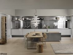 An Arclinea kitchen by Antonio Citterio. Nice use of contrasting the stainless steel kitchen with the raw wood dining table. New Kitchen Designs, Interior Design Kitchen, Kitchen Decor, Kitchen Ideas, Kitchen Rug, Kitchen Backsplash, Built In Kitchen Appliances, Kitchen Cabinets, Kitchen Carts