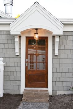 Love the little portico roof and the door! Need something like that on our house.
