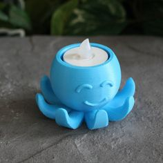 Charm and character is given to any simple tea light with this playful octopus design. It is easily printable by any consumer grade machine and looks good in a variety of colours.   This design is intended for electric tea lights only. Please do not put a live flame near your 3D prints.