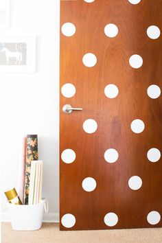 Add some charm with polka dots to a door for a fun and playful look. Cute for a kid's room or even an office.