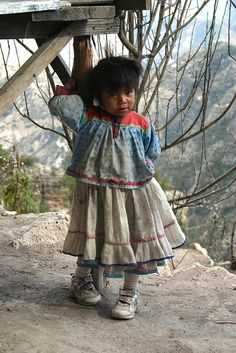 Tarahumara child, a native Indian tribe of Mexico's far northwest (originally inhabited much of Chihuahua). In their community, the men especially, are reknowned for their long-distance running skill.