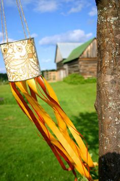 Windsock made using an old tin can, ribbon and twine. A use for 1 of the useless formula cans I saved.