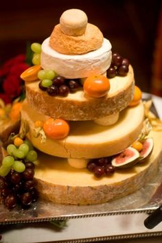With this -the cheese wheels are boosted and have fruits spilling out between the layers, looks even more like a wedding cake