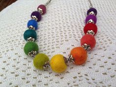 Adjustable size rainbow necklace from handmade felt balls and metal flower shape beads. It soft and comfortable to wear, and it looks georgeous. Make it happy who wear i, and who watch it :)