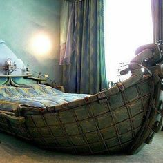 Old wooden boat made into a bed.