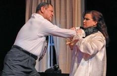 """In Topeka Civic Theatre & Academy's production of """"Prescription: Murder,"""" Dr. Roy Flemming (Jim Ramos), left, strangles his wi..."""