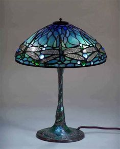 Lamp designs of Tiffany-Studios New York We keep the tradition of leaded glass lamp making alive. Since more than 25 years, we create extraordinary reproductions of Tiffany lamp designs for our customers worldwide. Tiffany Stained Glass, Stained Glass Lamps, Tiffany Glass, Leaded Glass, Stained Glass Windows, Mosaic Glass, Antique Lamps, Vintage Lamps, Tiffany Ceiling Lights