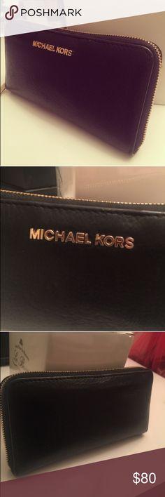 Michael Kors Wallet Like new! Black wallet with gold zipper. No damage at all. Michael Kors Bags Wallets