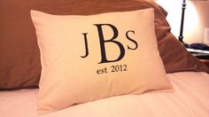 Just finished making this for a bridal shower gift. DIY: Freezer paper stencil monogram on simple envelope pillow cover.