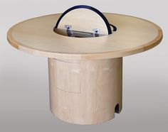 CTC-48 Custom Collaboration Table in Natural Maple - Open View. This compact table can seat 4 to 5 people and connect their laptops. A door on the pedestal gives access to wiring, a shelf, or even a half rack. Larger or smaller sizes are available. Any table edge is available. #Collaboration #Table #Custom #Infocomm2012