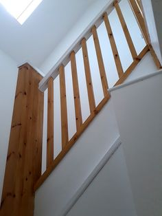 A double winder staircase including a return balustrade on the landing. 35mm square spindles and newels were chosen finished with pyramid newel caps. The handrail has been painted to create a striking contrast. Bespoke Staircases, Wooden Staircases, Curved Staircase, Staircase Design, Glass Stairs, Metal Stairs, Painted Stairs, Staircase Manufacturers