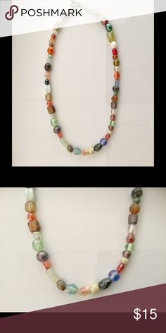 Multi-Colored Iridescent Beaded Necklace This is a handmade item with beautiful beads! Iridescent glass beads of many colors makes this necklace a must have for your collection! A toggle clasp makes it easy to fasten! Jewelry Necklaces