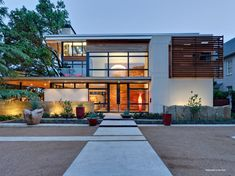 """Dallas-based architect Tom Reisenbichler designed the Caruth Boulevard Residence, a LEED Gold contemporary home located in Dallas, Texas, USA.            Caruth Boulevard Residence by Tom Reisenbichler: """"In our world where many associate sustainable (green) design with a bohemian lifestyle, while others consider luxury wasteful, this house is designed to prove they are not exclusive. Integrated tightly into the large iconic trees on the site, this house uses traditional home proportions to…"""