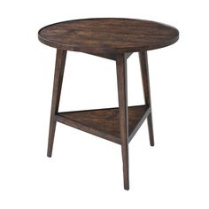 """A reclaimed oak veneered and mahogany cricket table, the circular planked top with a raised edge, on three splayed tapering legs joined by a triangular undertier. Dimensions: 26"""" W x 26"""" D x 26.25"""" H"""