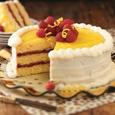 Raspberry Lemon Cake Recipe -Want a change from chocolate cake? Try this elegant lemon cake...it's packed with refreshing lemon flavor, from the cake to the homemade lemon curd and creamy frosting. It won a blue-ribbon at an Alaska State Fair and it's definitely a winner with me.—Shirley Warren, Thiensville, Wisconsin