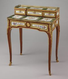 Small writing desk (bonheur-du-jour) Maker: Martin Carlin (French, near Freiburg im Breisgau ca. 1730–1785 Paris) Factory: Porcelain plaques by Sèvres Manufactory (French, 1740–present) Decorator: Decorated by Denis Levé (French, active 1754–93, 1795–1805) Date: ca. 1768 Culture: French, Paris and Sèvres Medium: Oak veneered with tulipwood, amaranth, and stained sycamore; mahogany; seventeen soft-paste porcelain plaques; gilt-bronze mounts; velvet (not original)