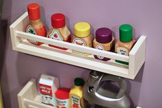 PLAY KITCHEN- Ikea spice rack hack on side of playset...