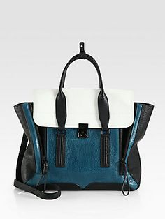 "3.1 Phillip Lim Pashli Colorblock Satchel    Structured colorblock design in rich pebble-grain leather, finished with expandable side gussets.  Adjustable detachable shoulder strap, 23""-26½"" drop  Double top handles, 3½"" drop  Push-lock on front flap  One inside zip pocket  Fully lined  18½""W X 11¼""H X 3¾""D  Imported"