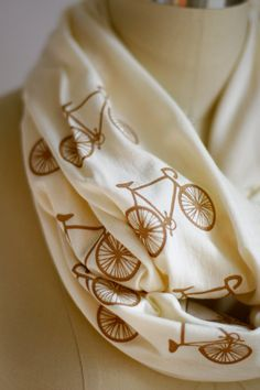 Not that I would need another scarf but I do love biking!
