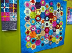 Like the bright colors in this hexagon quilt.....amitie textiles