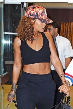 8 of Rihanna's sporty hairstyles that go with a baseball cap
