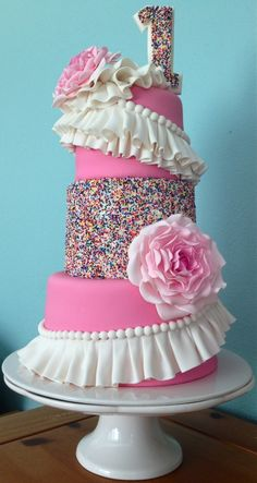 #Pink Tiered #Birthday #Cake with #Sprinkles #Ruffles and #Flowers Great #CakeDecorating - We love and had to share!