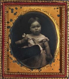 ca. 1850, [daguerreotype portrait of a young girl, posing reluctantly with a parent holding her in place]  via the Smithsonian American Art Museum, Photography Collection