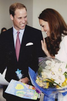 Rare! Catherine giggles and touches William's arm. :)