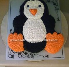 Homemade Penguin Cake: I used a teddy bear shaped cake pan to make this Penguin cake.  I cut off the ears and shaped the feet to make it look like a penguin. I used chocolate