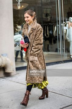 Jenny Walton wears a vintage fur coat, Gucci Prefall 2016 metallic gold skirt, and brown leather Prada boots during New York Fashion Week: Women's Fall/Winter 2016 on February 11, 2016 in New York City.