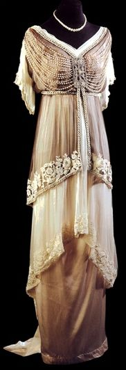 """1910's Evening Dress -  waistlines were high (just below the bust), echoing the Empire or Directoire styles of the early 19th century. Full, hip length """"lampshade"""" tunics were worn over narrow, draped skirts"""