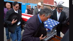 """Pallbearers carry the casket of <a href=""""http://www.nytimes.com/2016/04/05/us/joseph-medicine-crow-tribal-war-chief-and-historian-dies-at-102.html"""" target=""""_blank"""">Joe Medicine Crow,</a> a historian and the Crow Tribe's last surviving war chief, during his funeral service in Montana on Wednesday, April 6. He was 102 years old."""