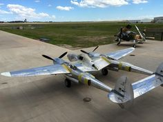 """P-38F """"White 33"""" with the Skyraider in the background. BFD"""