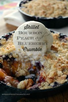 Skillet Bourbon Peach and Blueberry Crumble | ©homeiswheretheboatis.net #summer #desserts #peach #skillet #bourbon #blueberry