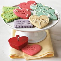 Set includes a variety of cutter shapes, words and letters for custom cookie designs.  Three cutters in scalloped-rectangle, heart and star shapes.  Seven pre-made word stamps: Welcome, Happy, Birthday, Holidays, Thank You, From and I Love You.  Three sets of alphabet letter stamps (plus extra vowels and other commonly used letters).  Press the cutter into the dough and your lettering is imprinted on the cookie.  Mesh bag for storage.  A Williams-Sonoma exclusive.